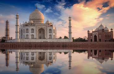 Fototapete - Taj Mahal with a scenic sunset view on the banks of river Yamuna. Taj Mahal is a white marble mausoleum designated as a UNESCO World heritage site at Agra, India.