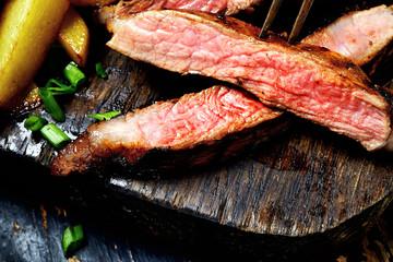 Steak  on a wooden background