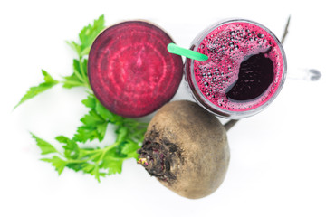 Beet smoothie with grapefruit and parsley on wooden table top view.