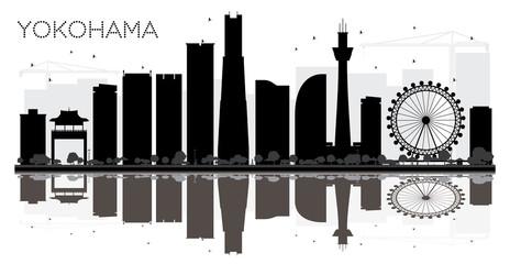 Yokohama City skyline black and white silhouette with reflections.