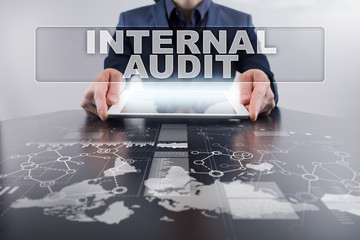 Businessman using tablet pc and selecting internal audit.