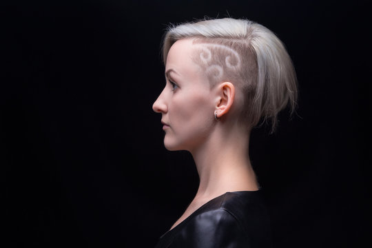 Portrait of blond woman with shaved head