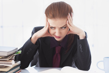 Businesswoman in problems. Alone working in office with a lot of documents. Yelling and screaming for bad results. (psychological portrait, aggression, anger, frustration)