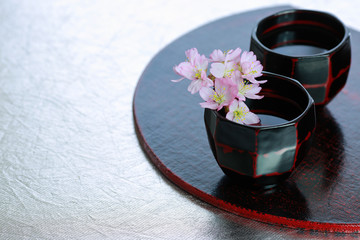 Japanese traditional sake cups with sakura flowers.