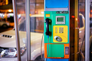 Urban design. Colorful street telephone.