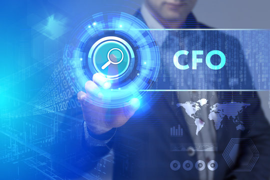Business, Technology, Internet and network concept. Business man working on the tablet of the future, select on the virtual display: CFO