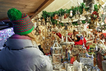 Woman at counter on Christmas market at Cathedral Square Vilnius