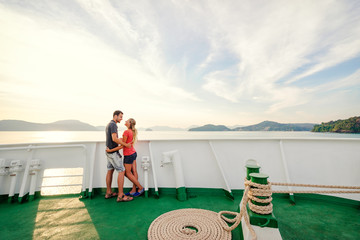 Romantic vacation. Young loving couple enjoying sunset on cruise ship deck. Sailing the sea.
