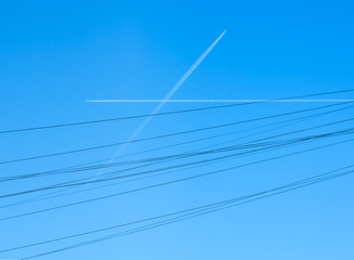 Canvas Print - airplane paths crossed in the sky like wires