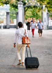 Woman with trolley luggage bag in Bern