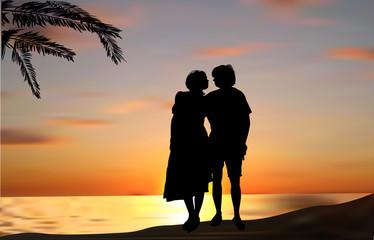 couple under palm tree near sea