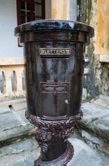 Vintage old dark metal mailbox