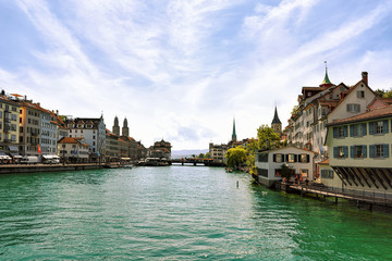 Limmat River quay with spires of main churches of Zurich