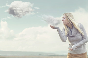 woman with magical powers creating clouds blowing