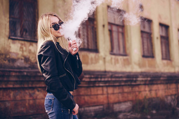 Vaping. Young beautiful woman vaping . Vapor concept.