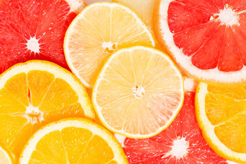 Slices of fresh citrus, closeup top view