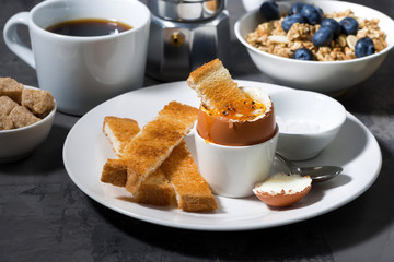 soft boiled egg, toasts and coffee for breakfast