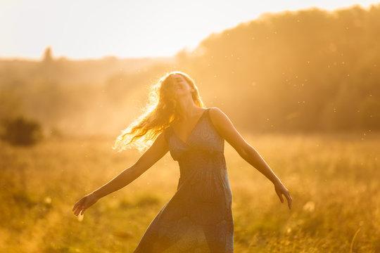 Dancing girl at sunset
