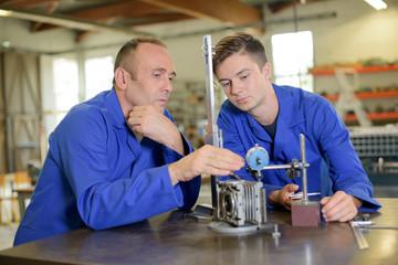 Supervisor instructing junior engineer