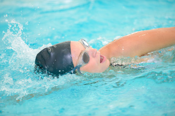 Female swimmer doing front crawl