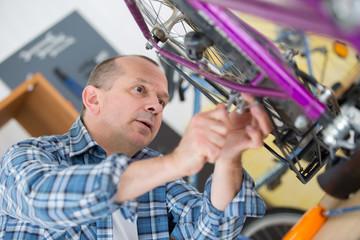 business owner repairing bicycle