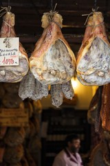 The famous Norcia's ham exposed in one of the many shops in the old town, Norcia, Italy