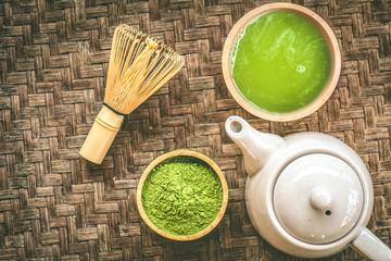 Matcha tea on wood texture