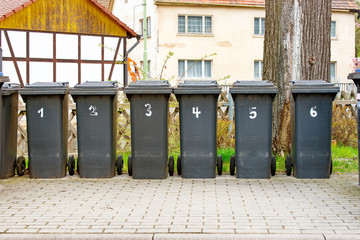 Numbered garbage cans for household waste