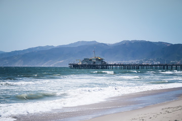 Santa Monica Beach with pier and mountains in disant background