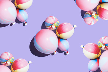 Multicoloured balloons against purple background