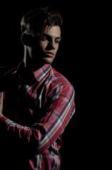 Handsome man posing in red plaid tshirt