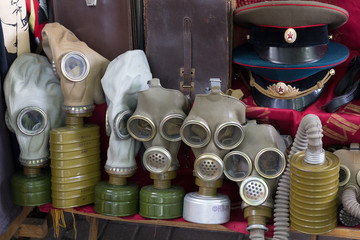 Gas masks and a Soviet military uniform on the flea market. Kiev, Ukraine