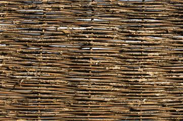 Obraz wicker fence of twigs - fototapety do salonu