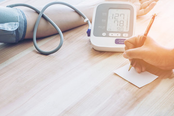 Doctor cardiologist measuring blood pressure of male patient
