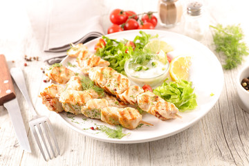 grilled chicken skewer and salad