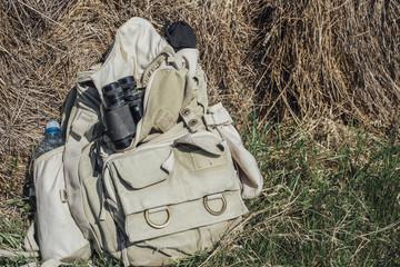 Backpack in front of haystacks