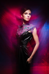 Young, beautiful and seductive girl posing in dress. Mixed and fashionable lightning effect.