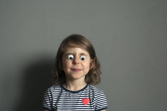 child is kidding: Put doll's plastic eyes