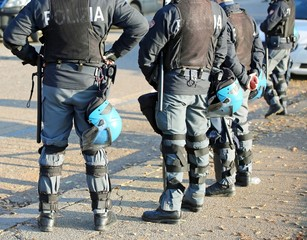 Italian police in riot gear with flak jackets and protective hel