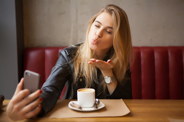 gorgeous blond girl resting in cafe
