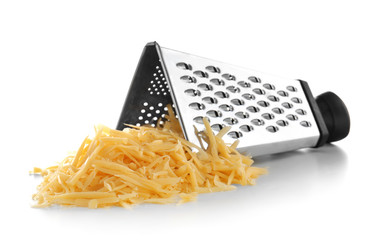 Metal grater and pile of cheese isolated on white