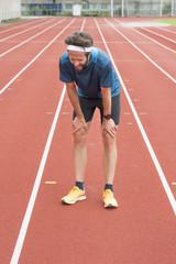 Sweden, Skane, Malmo, Athlete standing on track
