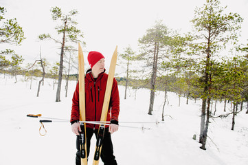 Sweden, Vastmanland, Skier standing in Kindla nature reserve