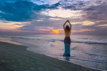 Beautiful woman standing on the beach