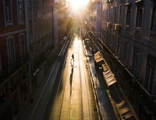Portugal, Lisbon, Silhouette of pedestrian crossing empty street