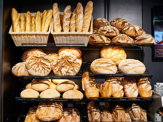 Fresh bread on shelves in bakery