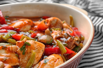 Delicious chicken cacciatore in baking dish, closeup