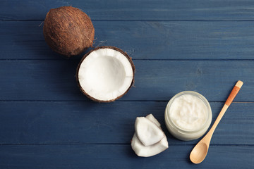 Composition with fresh coconut oil on wooden background