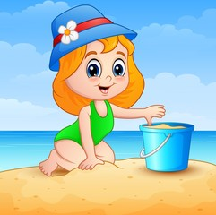 Little girl cartoon playing a sand on beach
