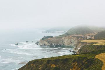 USA, California, Big Sur, Bixby Creek Bridge, Rocky coast with bridge in distance